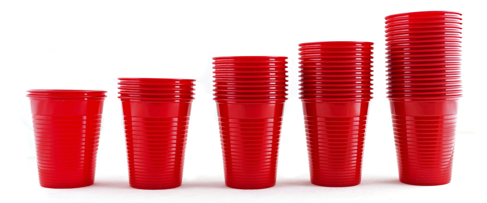 Plastic red cups stacks isolated on white background